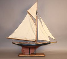 "Vintage pond yacht of the gaff rigged racing yacht ""Columbia""."