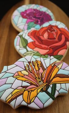 Amazing stained glass flowers decorated sugar cookies by The Hungry Hippopotamus - red rose, carnation, lily.