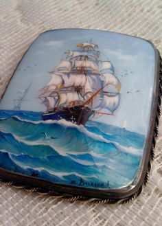 Ship brooch, enamel over silver