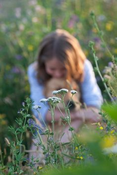 www.toddandmoore.co.uk portrait photography. Portrait of girl with dog and wild flowers.