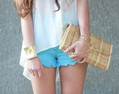 Love the straw clutch, gold cuff & scalloped shorts.. All in the details & pairing.
