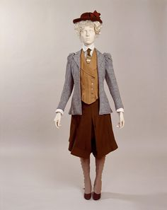 """This cycling outfit comprises a jacket, waistcoat and bloomers, with a brown felt hat printed with a """"time to light-up table"""" inside, for night-time cycling."""