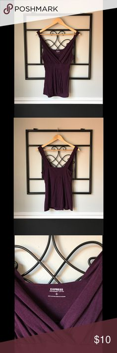 Purple Express Top! Size small purple top from Express! Pre-loved and in good condition. The straps have knots in the design and the front has a section of fabric that flows beautifully. It has a deep v-neck and could fit a medium as well. Dreamweight Cotton, 60% Cotton and 40% Modal. Express Tops Blouses