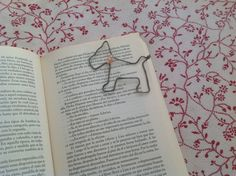 Hey, I found this really awesome Etsy listing at https://www.etsy.com/listing/245836374/dog-bookmark-handcrafted-wire-bookmark