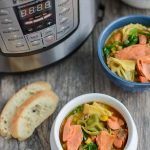 This Instant Pot Salmon Tortellini Soup recipe is simple, healthy and so easy to make for dinner. It uses ingredients from your freezer so its perfect for a night when you need a last minute meal.