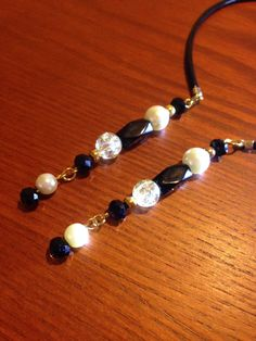 BEAUTIFUL! Handmade beaded bookmark/ book thong with leather cord. by CraftyLadyDez on Etsy