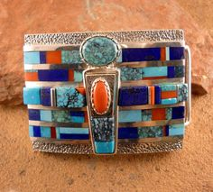 Inlaid sterlig silver belt buckle with Turquoise, Coral, & Lapis.  VERNON A. BEGAYE.