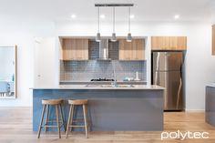 Melamine doors, drawers and panels  in Strata Grey Sheen Melamine overhead cupboards  in Natural Oak Matt