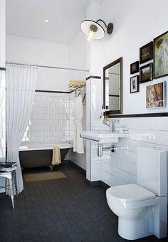 Black hexagonal tiles on floor of white and black bathroom.