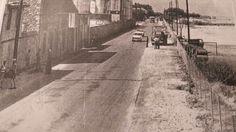 """Μια σπάνια φωτογραφία του δρόμου Πατρών-Ιτεών (η σημερινή Ακτή Δυμαίων) με ενα ρεύμα κυκλοφορίας σε πρώτο πλάνο το εργοστάσιο της ΒΕΣΟ και ενα αυτοκίνητο της εταιρείας αναψυκτικών """"ΑΣΣΟΣ"""" και στο βαθος το λεωφορείο της γραμμής ( φωτόγραφία απο το αρχείο του δημοσιογράφου Νίκου Στεφανόπουλου, από το βιβλίο του Σοφοκλή Κολαϊτη """"Αναδρομή σε δύσκολους καιρούς"""", από τις εκδόσεις ΤΟ ΔΟΝΤΙ. Greece Pictures, Vintage Pictures, Sidewalk, Side Walkway, Walkway, Vintage Photography, Walkways, Pavement"""