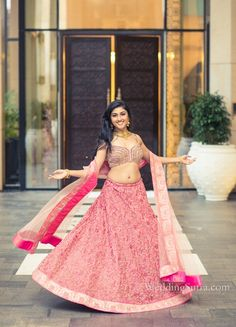 A beautiful Pink Lehenga with heavy embroidery by Jade by Monica & Karishma at WeddingSutra on Location.