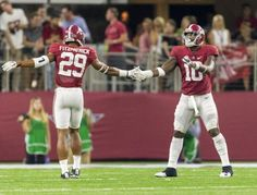 Alabama defensive back Minkah Fitzpatrick (29) and Alabama linebacker Reuben Foster (10) celebrate a stop during during the second half of Alabama's football game with Southern Cal, Saturday, Sept. 3, 2016, at AT&T Stadium in Arlington, Texas. Vasha Hunt/vhunt@al.com