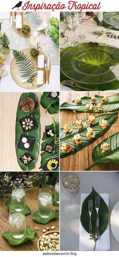 mesa posta decorada com folhas e folhagens sobre o prato, petiscos e copos.