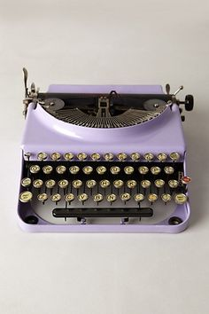 Okay, I know this sounds crazy, but... for a long time now I have been asking for a typewriter. I'm like in love with antiques and anything and everything that is vintage! Purple is my all time favorite color and this typewriter is purple! It's so perfect! I want, I need! Lol!