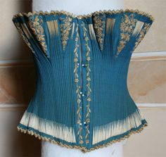 1850s-60s blue embroidered corset - the whalebone is either very small, or this corset is corded (which wasn't uncommon for this period)