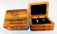 DOUBLE Ring Large Square Design  This box holds both rings.  Use it during the ceremony instead of a ring pillow.  Standard engraving of your names and date  are included in the price.  As an added option, we can also put special logos/artwork or YOUR own artwork on the box. How about putting the message in YOUR own Handwriting!!   Comes in a variety of woods:   LRB-Double-Alder, Maple, Blue Pine, Mahogany, Walnut, and Amber Bamboo (see sample) $40.00  Made in the USA