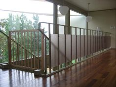 Look! Stylish Babyproofed Stairs and Railing in Mid-Century Home