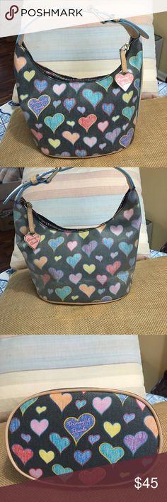 "Donney and Bourke heart Bucket bag Cute  Dooney& Burke heart bucket bag with coded canvas zip closure inside key holder inside zipper pocket three slit pockets adjustable handle strap dimensions are 6""deep 11 ""across  5 1/2 ""bottom Dooney & Bourke Bags Shoulder Bags"