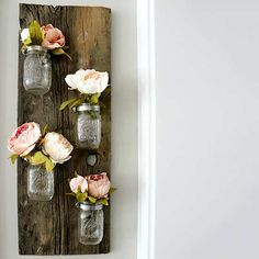 Form meets function in this rustic and adorable Mason jar flower holder.