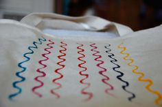 Canvas Tote Printing Project by Kristen Sutcliffe from New House Project I love simple canvas tote bags to carry groceries or our family's supplies for a day out. I decided to dig through Saya's play dough tools to come up...