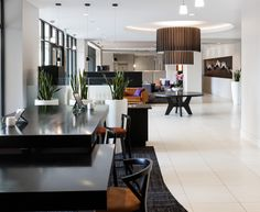 Kent Place Luxury Apartments - With statement lighting, white tile floors and a burnt orange accent color, this clubhouse has a luxurious feel for building residents.