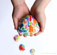 Make beautiful rainbow Melted Crayon Seashells out of shells from the Dollar Tree!