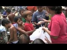 Hope House Cebu feeds the kids in their burned out homes...