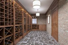 The wine cellar door is an important aspect to the overall appeal of your wine cellar. Here are things to keep in view while choosing a wine cellar door. Wine Cellar Basement, Wine Cellar Racks, Wine Cellars, Custom Home Builders, Custom Homes, Wine Cellar Design, Southern House Plans, Basement Renovations, Dream House Plans