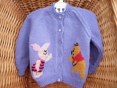This lavender girls' cardigan fits a 20 inch chest or a 1 year old. It has Winnie The Pooh and Piglet on the fronts and Eyeore on the back. by Marionsknittedtoys on Etsy