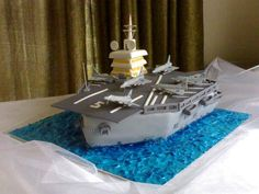 An aircraft carrier cake with edible everything. (apart from the board :) Johannesburg based.