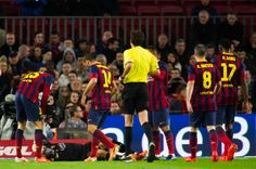 Victor Valdes (2nd L) of FC Barcelona lays injured on the ground during the La Liga match between FC Barcelona and RC Celta de Vigo at Camp Nou on March 26, 2014 in Barcelona, Catalonia.