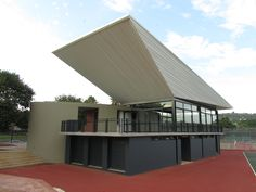 Afrikaanse Hoer Meisieskool Pretoria – New sports facility in Pretoria, South Africa. The brief called for a sports facility with a tuck shop, dressing rooms, ablutions, sport viewing venue and entertainment area thus the building becomes the core of the sporting hub. Visitors would know immediately where to go with the design being a focal point in the centre of the school. By Mathews and Associates Architects, completed in 2012. Photo by MAAA