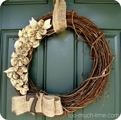 LOVE this rustic burlap grapevine wreath! via @kimtoomuchtime