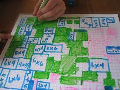 Multiplication Grid Game: roll die and color in grid, then solve. take turns with different colors until can't put any more in, then count up who has most pieces.
