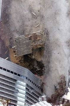 The Day of the Attacks - Debris rains down on the street as the South Tower of the World Trade Center collapses after hijacked planes crashed into the towers on September 2001 in New York City. World Trade Center Collapse, Trade Centre, 11 September 2001, We Will Never Forget, Powerful Images, Ex Machina, Sad Day, Jolie Photo, American History