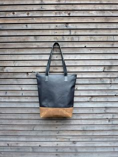 Black leather tote bag / shoulderbag made from oiled leather and waxed canvas bottom
