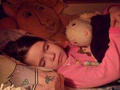 Wordless Wednesday {She's sleeping with my old stuffed animal.}