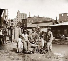 "Richmond, Virginia. Group of Freed Slaves (""Freedmen"") by canal"