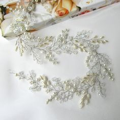 This romantic wedding hair accessory made of freshwater pearls ivory, Czech crystal, gold leaf with rhinestones. Dimensions: approximately 17 inches in length The headpiece is ready to ship! #bridalhairvine #bridal hair #vine Bridal #headband Bridal #hairjewelry #wedding wreath #pearl #crystalhairvine jewelry #pearlheadband #fashion #bridalstyle #bridalfashion #bridaldress