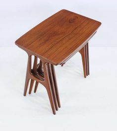 Set of Three Danish Modern Teak Nesting Tables Designed by Johannes Andersen | From a unique collection of antique and modern nesting tables and stacking tables at http://www.1stdibs.com/furniture/tables/nesting-tables-stacking-tables/