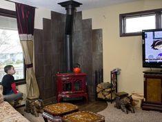wood burning stove in kitchen | Motoya Nakamura/The Oregonian A wood-burning stove sits in the corner ...