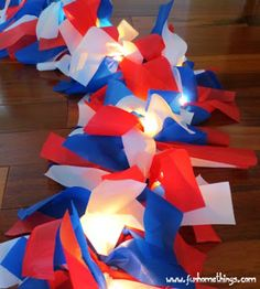 Patriotic Lit Garland DIY Cheap & easy! # [Plastic table cloths, clear Christmas lights,  scissors]