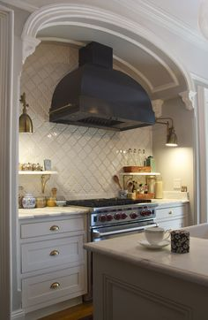 brownstone parlor kitchen w/ custom hood from indigo & ochre design