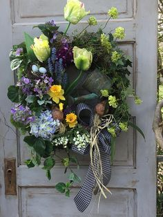 This Spring Wreath is Made on a Grapevine Base. I have Layered it with an abundance of Spring Bulb Flowers, and Branches to give it a Cottage Garden Look that I Love!! I Love manicured Gardens too...shoot really just love it all lol! I Added Flowing Branches of Lavender Lilac