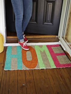 Nothing says Welcome Home like a homemade welcome mat! We've made a lot of painted rugs over the years, but I'm happy to report that this is our easiest and most durable version yet. I found this textured rug at Target and decided to try using porch paint instead of spray paint.