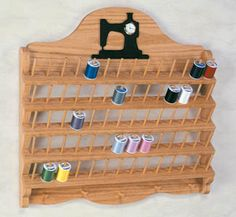 """Thread rack, $7.95, Item #: CC30. This rack is a sewers dream! It easily mounts on the wall and holds up to 56 spools of thread. Easy-to-follow pattern gives complete instructions from start to finish. (Approx 22"""" tall x 23"""" wide)"""
