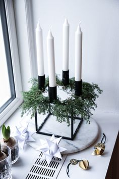 Beautiful and evocative Christmas styling of our Kubus candleholder by . Mini Christmas Tree, Nordic Christmas, Diy Christmas Ornaments, Christmas Time, Christmas Wreaths, Christmas Decorations, Xmas, Wine Bottle Centerpieces, Diy Centerpieces
