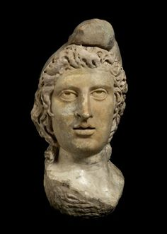 Back to Roman (AD 43 - AD 450)             Title:  Statue head of God Mithras: 2nd-3rd century    Description:  Statue head of God Mithras. This statue head was found buried in the Mithraeum floor at Bucklersbury House, Walbrook in 1954.