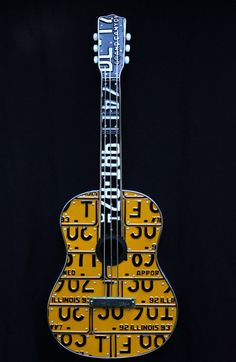 Love this guitar! I think my Daddy would thinks this rocks, he collects old license plates!!