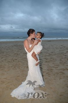 Beach Bride Kisses Infant In The Moonlight After Wedding Ceremony By Sea Ocean City